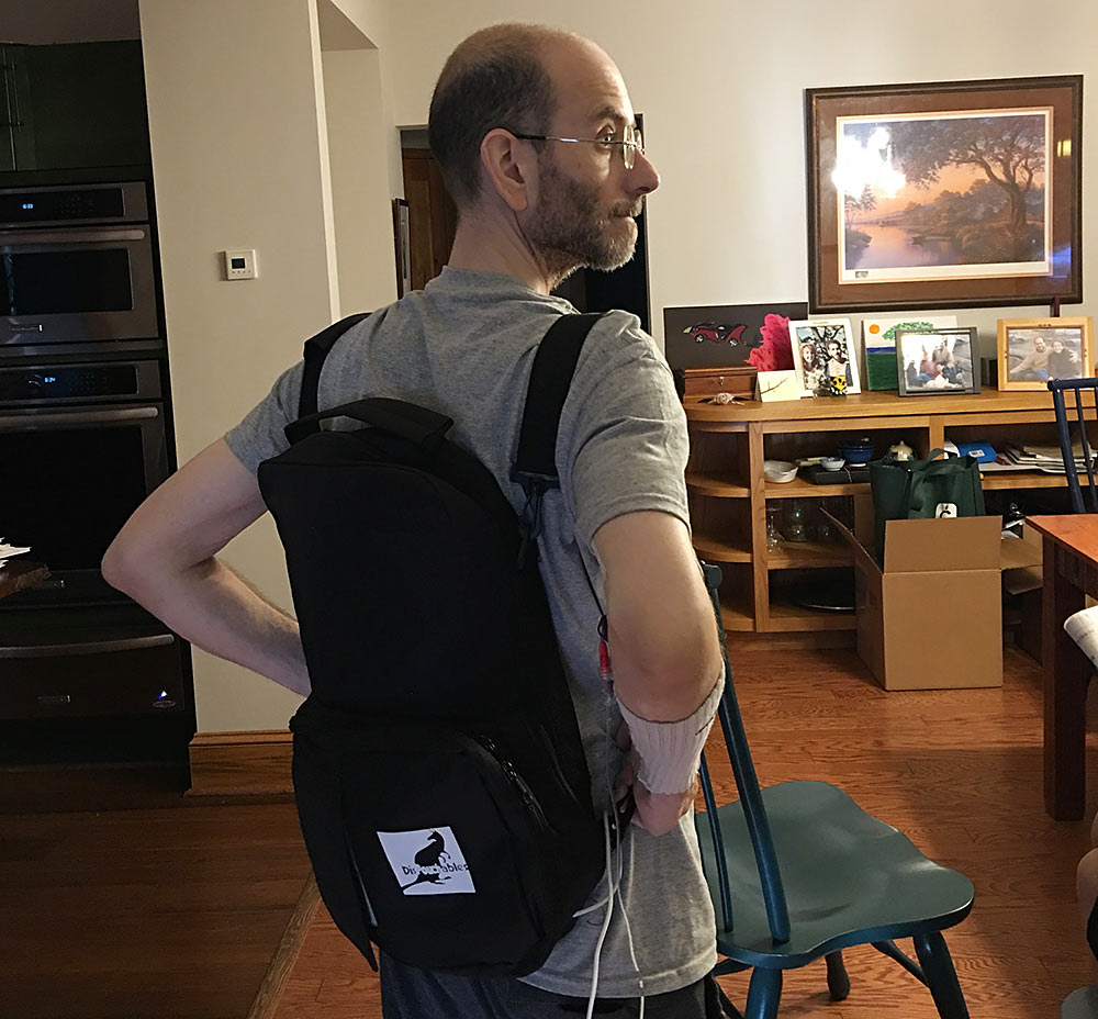 Elliot models the new plus-size TPN backpack