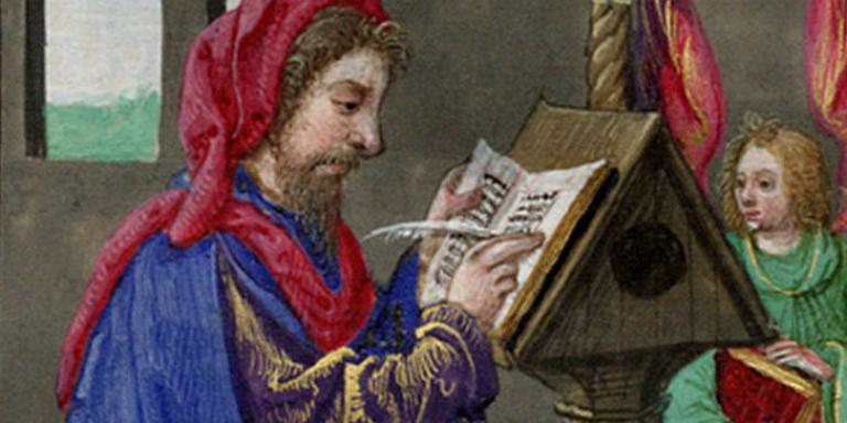 A medieval calligrapher scribes a book