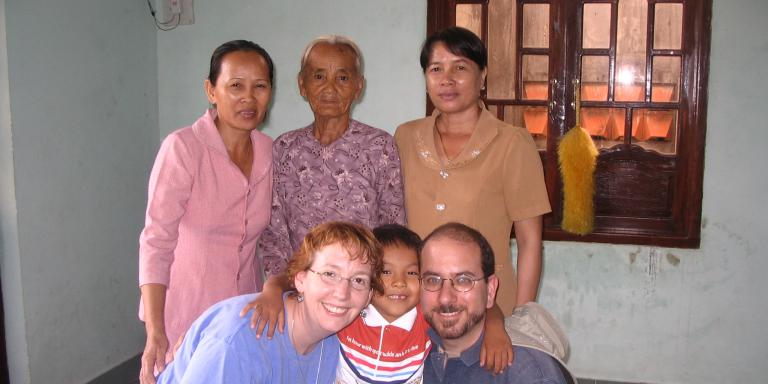 We pose with Logan, nanny Mei, her mother, and the orphange director