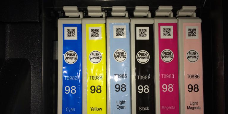 Cyan, magenta, yellow, and black printer ink cartridges