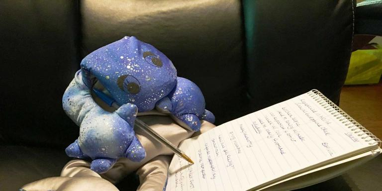Cyril the salamander takes notes during our interview.