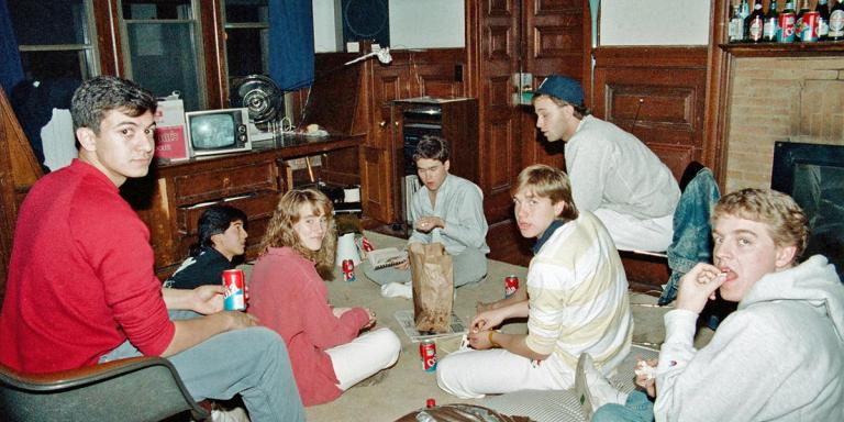 Gathering in our dorm's common room to share some food. Stereo system visible along rear wall.