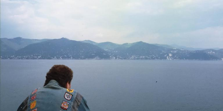 etg considers the the Italian coast near Portofino in his flag-emblazoned denim jacket