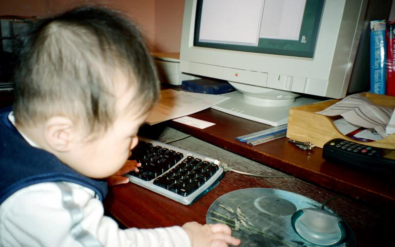 Baby Aidan on the computer