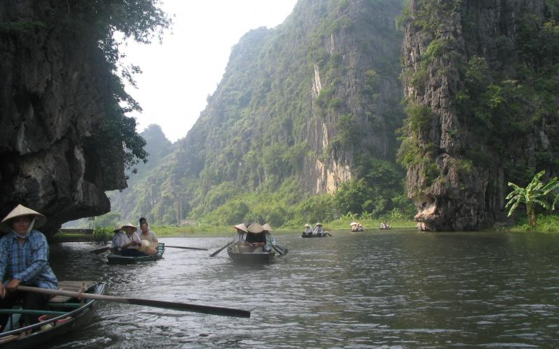 Boating down Tam Coc